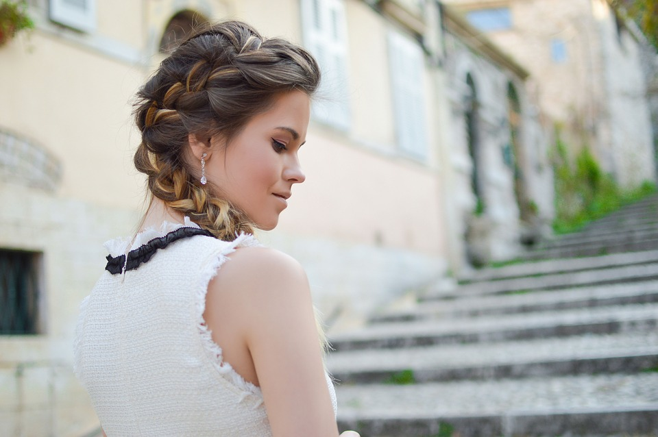 Side view of a woman with fishtail braid