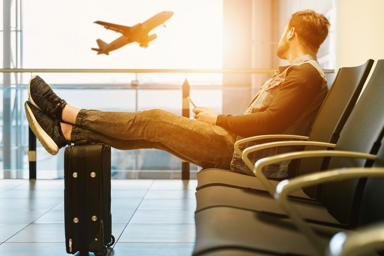 man sitting with luggage