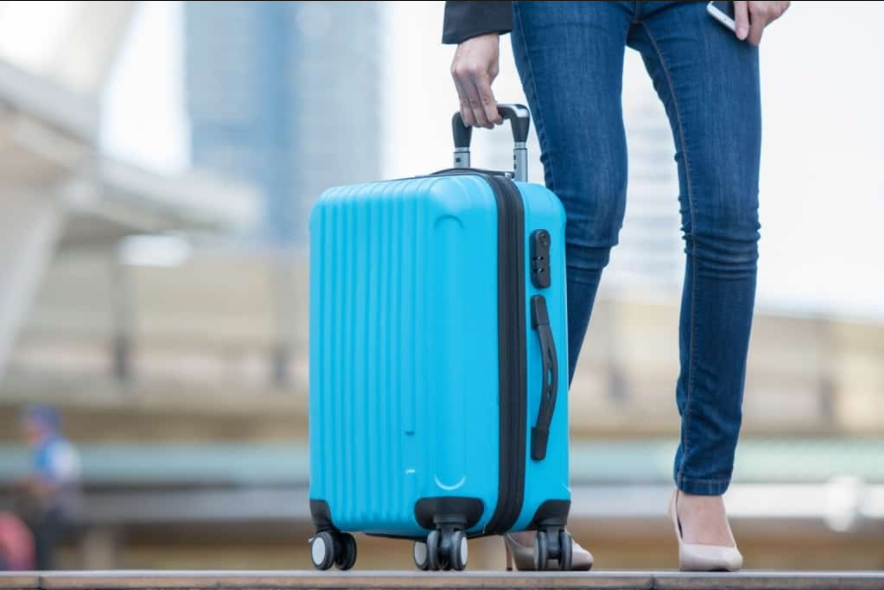 a woman holding her luggage bag