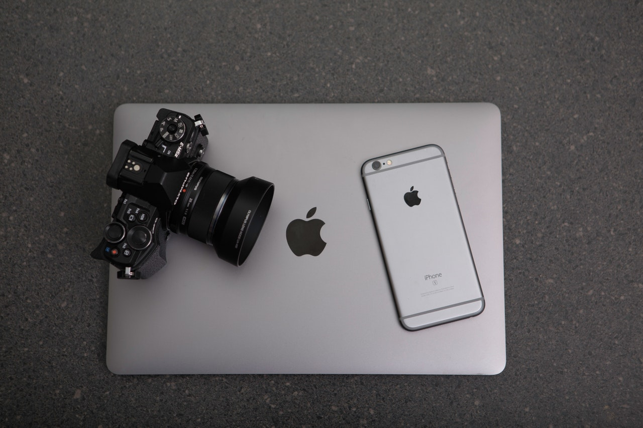 Macbook laptop, smartphone and a SLR