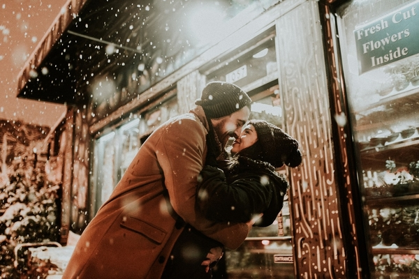 couple hugging each other during winter