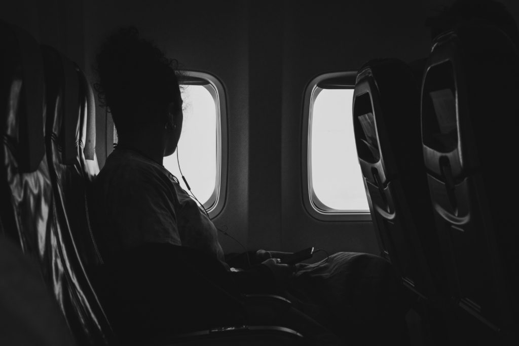 a woman looking out of the window of an airplane